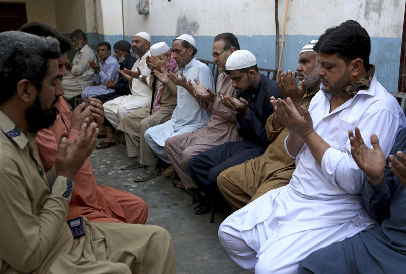 People pray for the soul of Ahsan Farooq, 19 year boy who was died due to toxic gas leak, at his residence in Kamari neighborhood of Karachi, Pakistan, Monday, Feb 17, 2020. Photo: AP