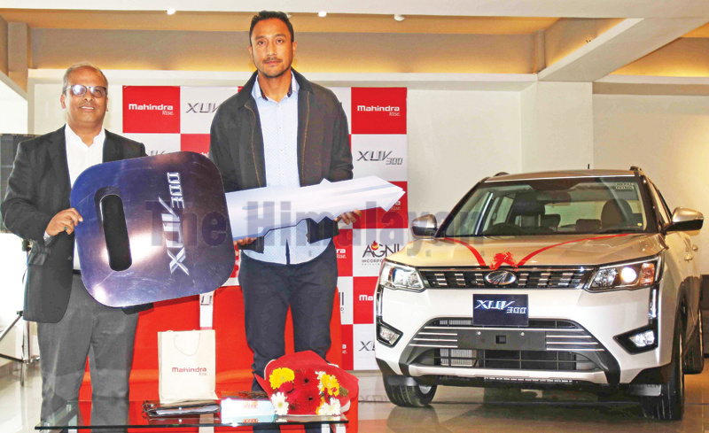 Paras Khadka (right) former skipper of national cricket team and brand ambassador of Mahindra and Mahindra receives key of his brand new Mahindra XUV 300 from Arjun Prasad Sharma Managing Director of Agni Group on marriage anniversary day after signing MoU with Agni Group at Panipokhari in Kathmandu on Wednesday. Photo: Udipt Singh Chhetry/THT