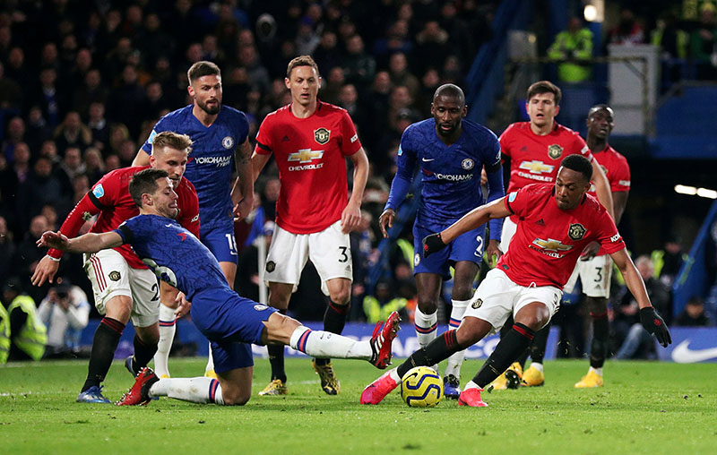 Manchester United's Anthony Martial in action with Chelsea's Cesar Azpilicueta during the Premier League match between Chelsea and Manchester United, at Stamford Bridge, in London, Britain, on February 17, 2020. Photo: Reuters