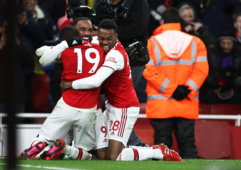 Arsenal's Alexandre Lacazette celebrates scoring their fourth goal with Nicolas Pepe and Joe Willock during the Premier League match between Arsenal and Newcastle United, at Emirates Stadium, in London, Britain, on February 16, 2020. Photo: Reuters