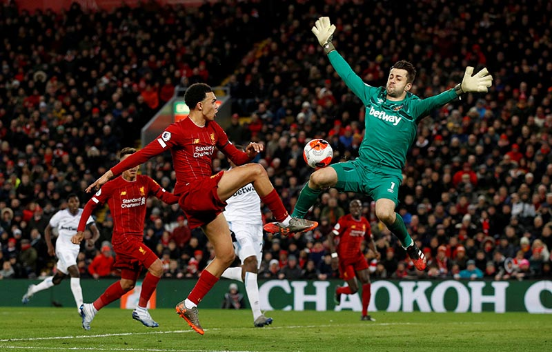 Liverpool's Trent Alexander-Arnold in action with West Ham United's Lukasz Fabianski before Sadio Mane scores Liverpool's third goal during their Premier League, at Anfield, in Liverpool, Britain, on February 24, 2020. Photo: Reuters