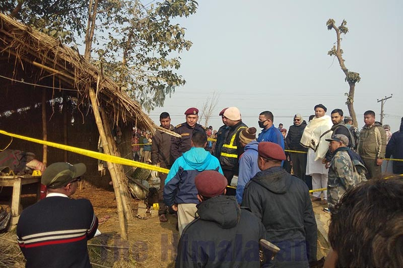 People gathering around the incident site cordoned off by police, at Devi Parsa village, in Durgabhagawati Rural Municipality-3, Rautahat district, on Tuesday, February 11, 2020. A senior citizen was found lying dead on his bed in a hut. Photo: Prabhat Kumar Jha/THT