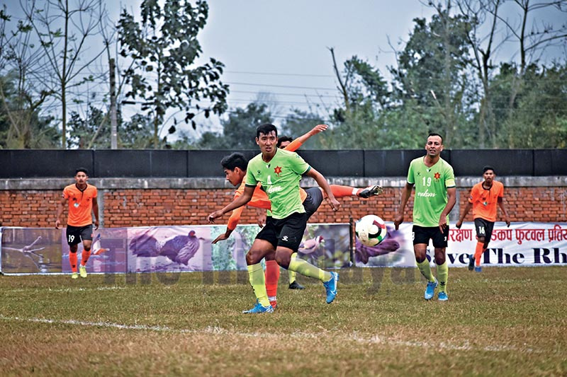Players of Tribhuvan Army Club (front) and Yeti Himalayan Sherpa Club in action during the fifth Rhino Gold Cup semi-final match in Nawalpur, on Monday. Photo: THT