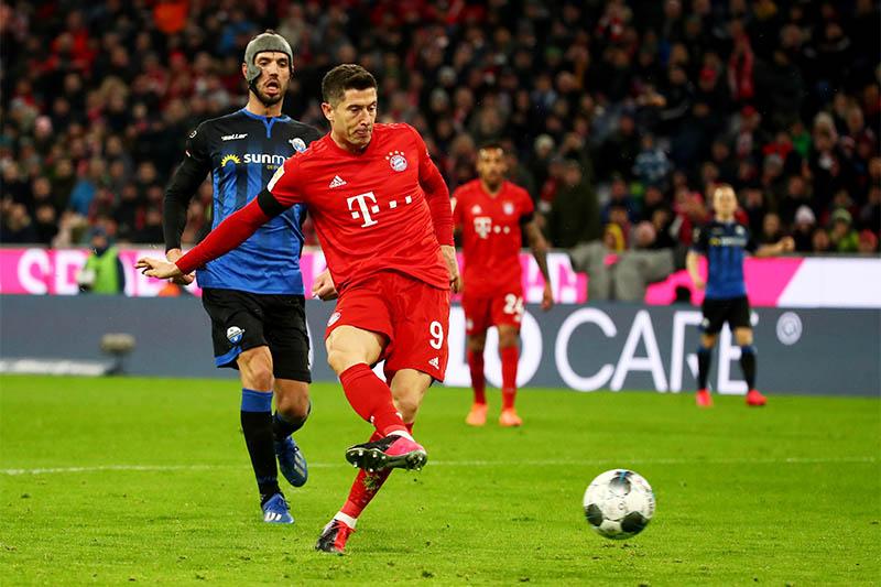 Bayern Munich's Robert Lewandowski scores their second goal. Photo: Reuters