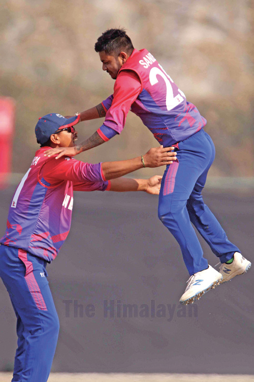 Sandeep Lamichhane (right) jumps to celebrate wickets with skipper Gyanendra Malla against the USA during the ICC Men's Cricket World Cup League 2 Tri-nations series at TU Cricket Stadium in Kathmandu on Wednesday. Photo: Udipt Singh Chhetry/THT