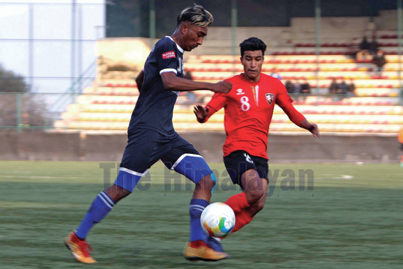 Sanjog Maharjan (left) of Friends Club dribbles the ball against Arik Bista of New Road Team during their Qatar Airways Martyr's Memorial A Division League match at ANFA ground, Satdobato in Lalitpur on Tuesday. Photo: Udipt Singh Chhetry