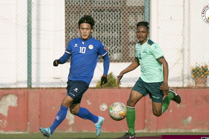 Sankata Club player in (blue jersey) and Saraswoti Youth Club vie for a ball at the ANFA Complex Ground during the national league on Thursday, February 13, 2020. Courtesy: ANFA/Facebook