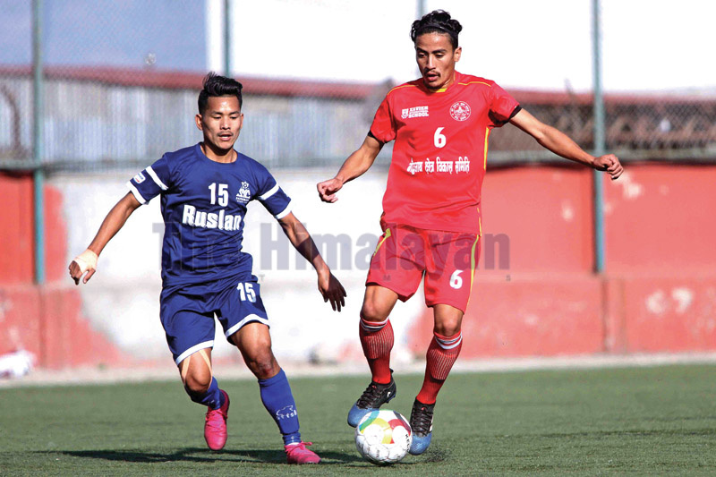 Roshan Bhujel (left) of Satobato Youth Club vies for the ball against Sudip Gurung of Tusal Youth Club during their Martyr's Memorial B Division League match at ANFA grounds in Lalitpur on Thursday.