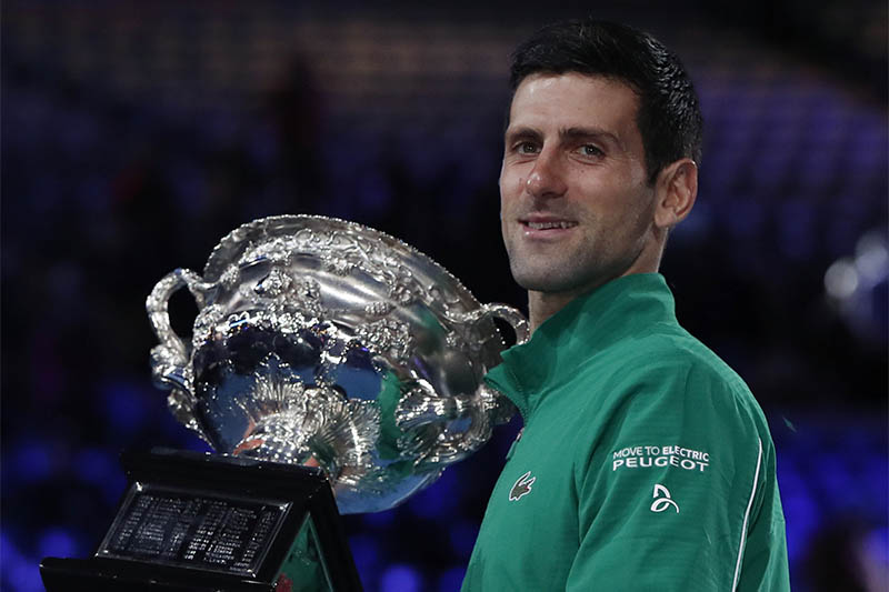 Serbia's Novak Djokovic celebrates with the trophy after winning his match against Austria's Dominic Thiem. Photo: Reuters