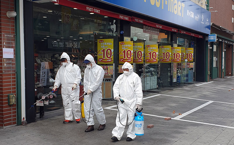 Employees from a disinfection service company sanitize a street in Daejeon, South Korea, February 22, 2020. Photo: Yonhap via Reuters