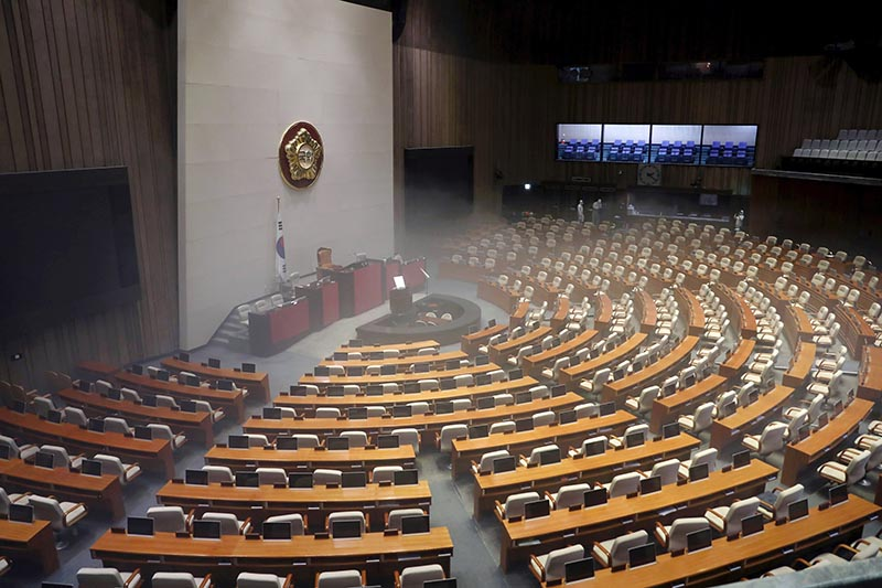 Employees from a disinfection service company sanitize the National Assembly in Seoul, South Korea, February 25, 2020. Photo: Yonhap via Reuters