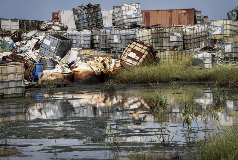 Containers used for hazardous chemicals lie exposed and piled up at a junkyard run by the Chinese-led Dar Petroleum Operating Company in Gumry, near Paloch, in South Sudan, Monday, Oct 1, 2018. Photo: AP