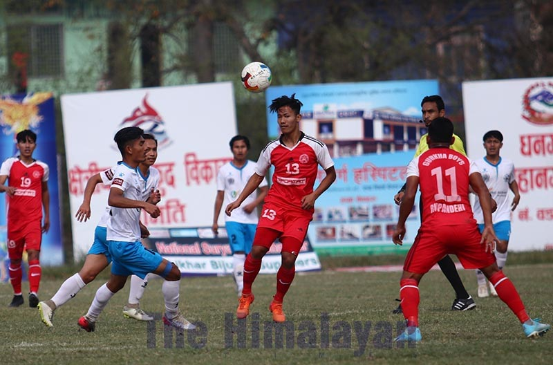 Players of Yeti Himalayan Sherpa Club and Gorkha Boys Club (right) in action during the quarter-final match of the Nepal Ice Sudurpashchim Khaptad Gold Cup at the Dhangadhi Stadium on Friday. Photo: THT