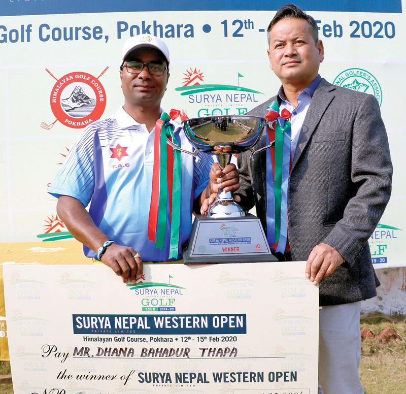 Dhana Bahadur Thapa (left) receives the trophy from Brand Manager of Surya Nepal Pvt Ltd Keshav Pradhan after the Surya Nepal Western Open in Pokhara on Friday. Photo courtesy: NPGA