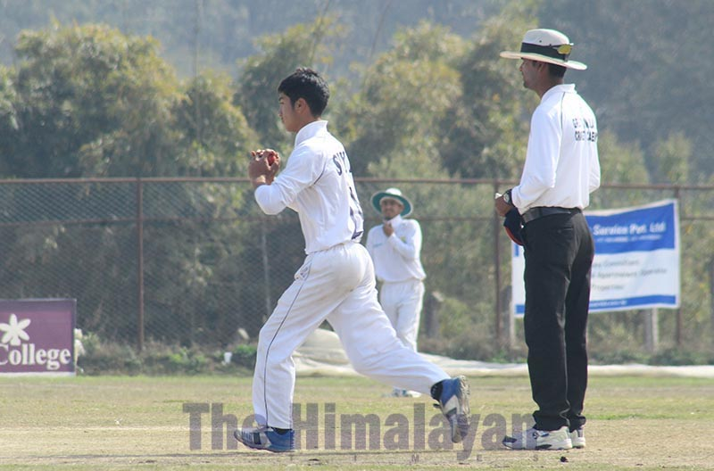 Surya Tamang of KCTC bowls against Oasis Cricket Academy during their Orchid College second Himalaya Cricket League match at the Mulpani grounds in Kathmandu on Friday. Photo: THT