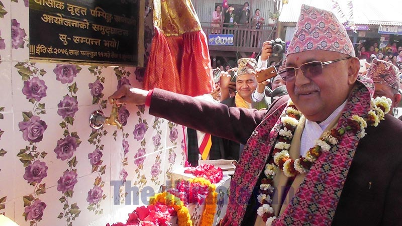 Prime Minister KP Sharma Oli inaugurating Tamor Lift Drinking Water Project by opening the tap at Kumyak Rural Municipality, in Panchthar, on Sunday, February 23, 2020. The inauguration coincided with the PMu2019s 69th birthday.Photo: THT