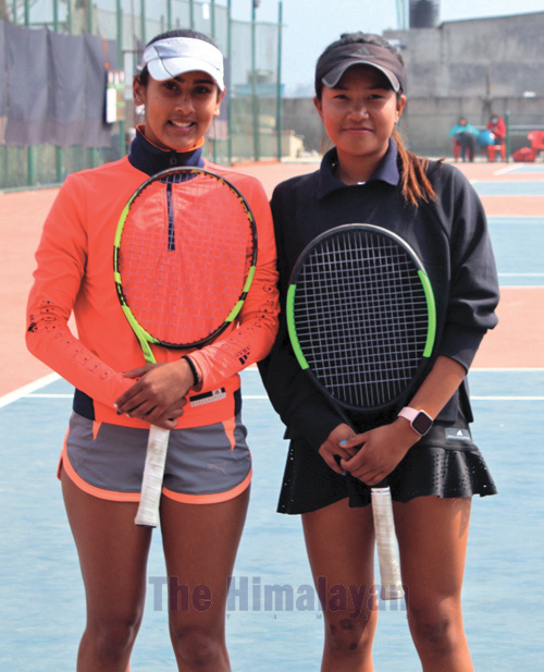 Nepalu2019s Prerana Koirala and Saloni Tamang (right) before their girlsu2019 doubles semi-final match of the Junior J5 Circuit-I Tournament under the ITF World Tennis Tour in Lalitpur on Thursday. Photo: THT