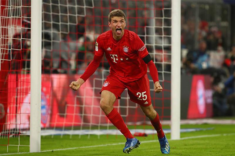 Bayern Munich's Thomas Muller celebrates scoring their second goal. Photo: Reuters