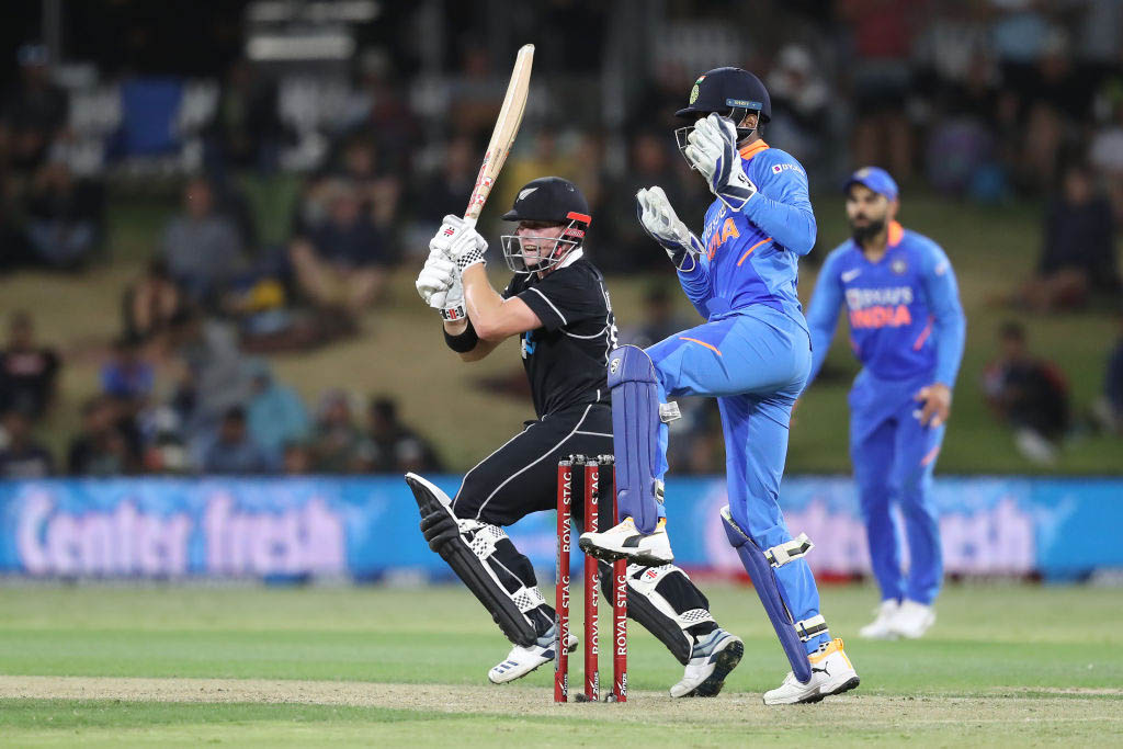 New Zealand's opening batsman Tom Latham plays a shot as Indian fielders loos on during the 3rd ODI in Bay Oval, on Tuesday, February 11, 2020. Courtesy: ICC/Twitter