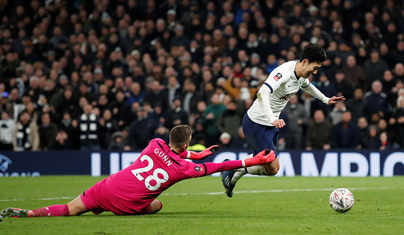 Tottenham Hotspur's Son Heung-min is fouled by Southampton's Angus Gunn resulting in a penalty during the FA Cup Fourth Round Replay match between Tottenham Hotspur and Southampton, at Tottenham Hotspur Stadium, in London, Britain, on February 5, 2020. Photo: Reuters