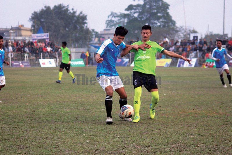 Players of Manebhanjyang FC and Tribhuvan Army Club (right) in action during the third Satakshi Gold Cup Football Tournament in Jhapa on Tuesday. Photo: THT