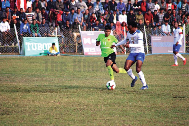 Players of Tribhuvan Army Club (left) and San Miguel Machhindra Club vie for the ball during their Satakshi Gold Cup match in Jhapa on Friday. Machhindra won the match 2-0. Photo: THT