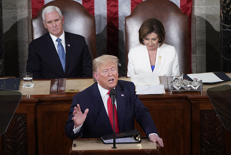 Vice President Mike Pence and Speaker of the House Nancy Pelosi (D-CA) listen as US President Donald Trump delivers the State of the Union address to a joint session of the US Congress in the House Chamber of the US Capitol, in Washington, on February 4, 2020. Photo: Reuters