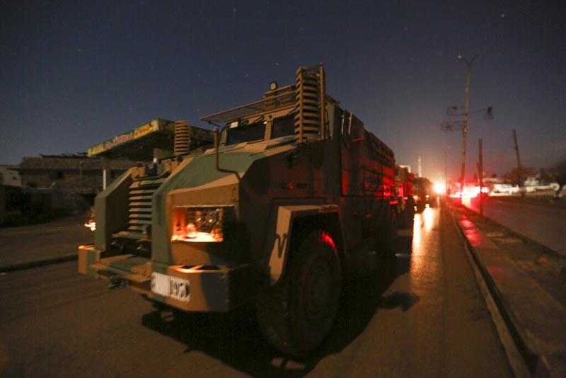 Turkish military convoy drives in Idlib province, Syria, Friday, February 7, 2020. Photo:AP