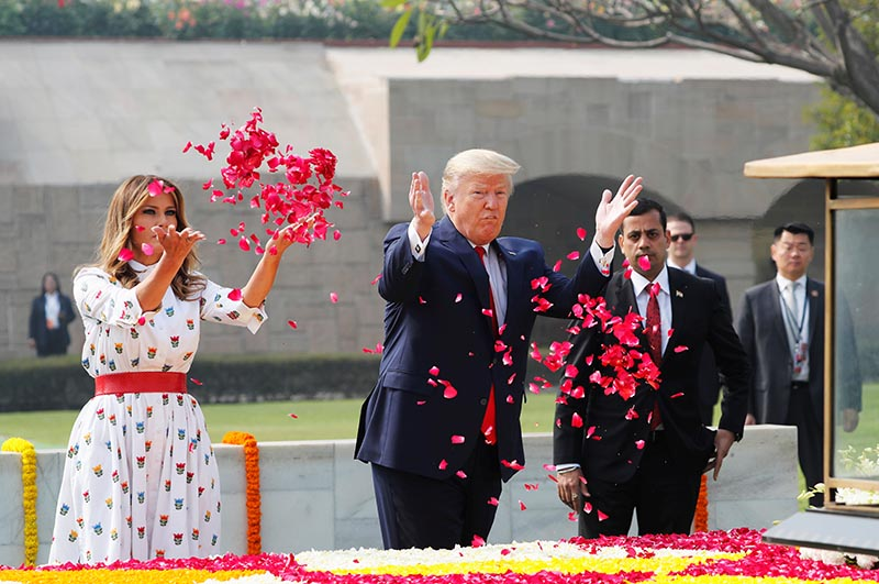 US President Donald Trump and first lady Melania Trump attend a wreath laying ceremony at Mahatma Gandhi's memorial at Raj Ghat in New Delhi, India, on Monday, February 25, 2020. Photo: Reuters