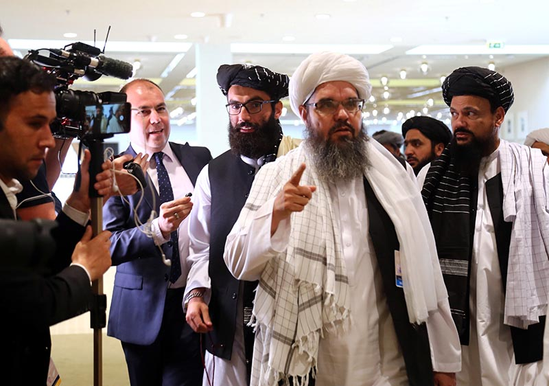 Members of Afghanistan's Taliban delegation speak to the media ahead of an agreement signing between them and US officials in Doha, Qatar February 29, 2020. Photo: Reuters