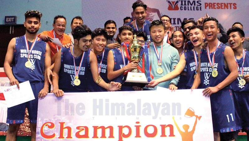 Players and officials of the White House International College celebrate with the trophy after winning the fifth Under-18 National Basketball Tournament in Kathmandu on Thursday. Photo: THT