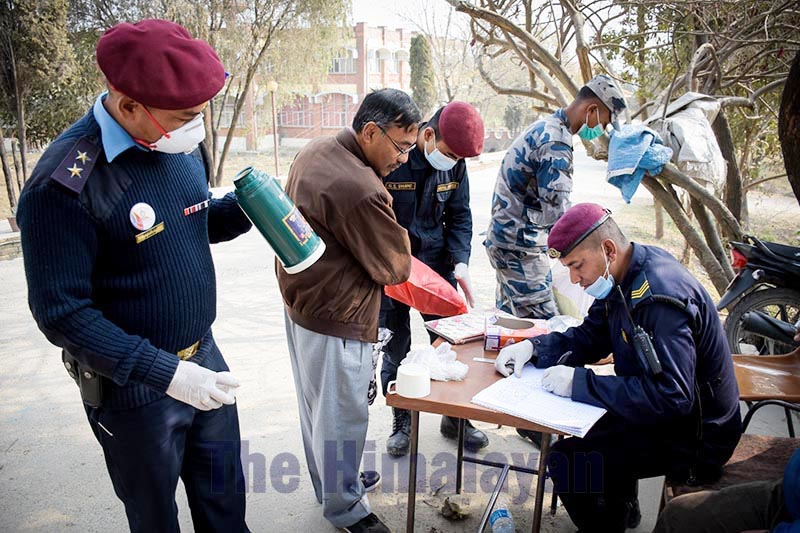 Security personnel checking goods, in Bhaktapur, on Monday, February 17, 2020. The families of airlifted evacuees from Hubei province of China visited the quarantine centre. Photo: Naresh Shrestha/THT