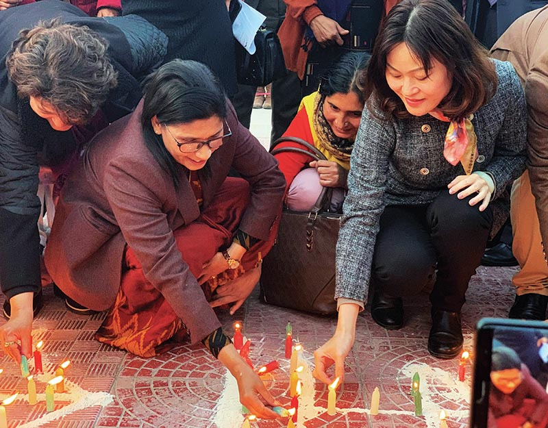 Minister of Land Management, Cooperatives and Poverty Alleviation Padma Kumari Aryal and Chinese Ambassador to Nepal Hou Yanqi lighting candles in the memory of those who lost their lives to coronavirus in Wuhan, China, in Kathmandu, on Wednesday. Photo: RSS