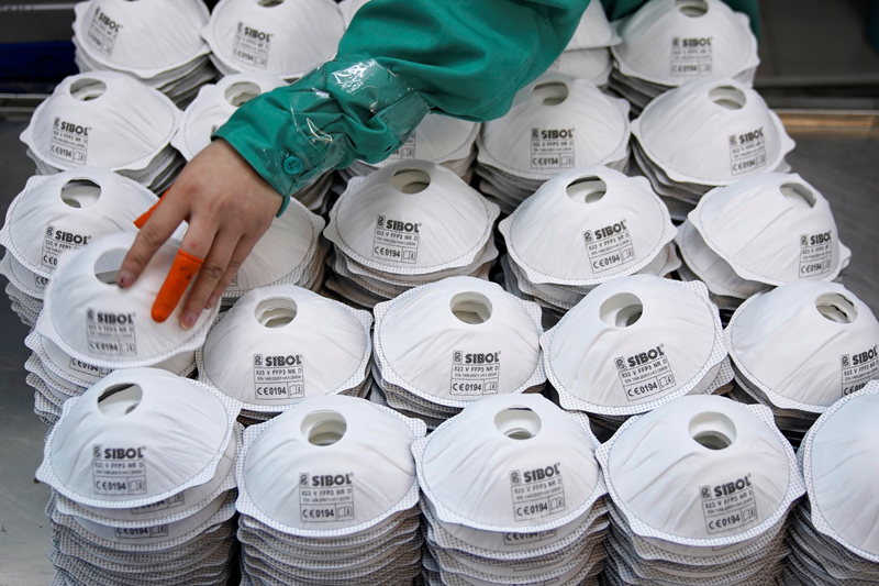 Masks are seen on a production line manufacturing masks at a factory in Shanghai, China January 31, 2020. Photo: Reuters/File