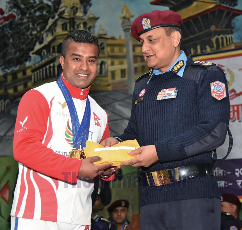IGP Sarbendra Khanal handing over the rewards to karateka Manday Kaji Shrestha in Kathmandu on Sunday. Photo: THT