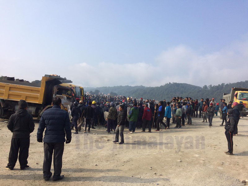 Locals and police gathering at incident site as irate locals set a tipper on fire after it hit and killed a woman, in Chhepetar, Gorkha, on Friday. Photo: THT