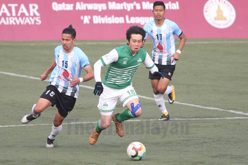 CYCu2019s Taiga Nakamura and NOC Manangu2019s Pujan Uparkoti (left) vie for the ball during their Qatar Airways Martyrs Memorial A Division League match in Lalitpur on Monday. Photo: Udipt Singh Chhetry / THT