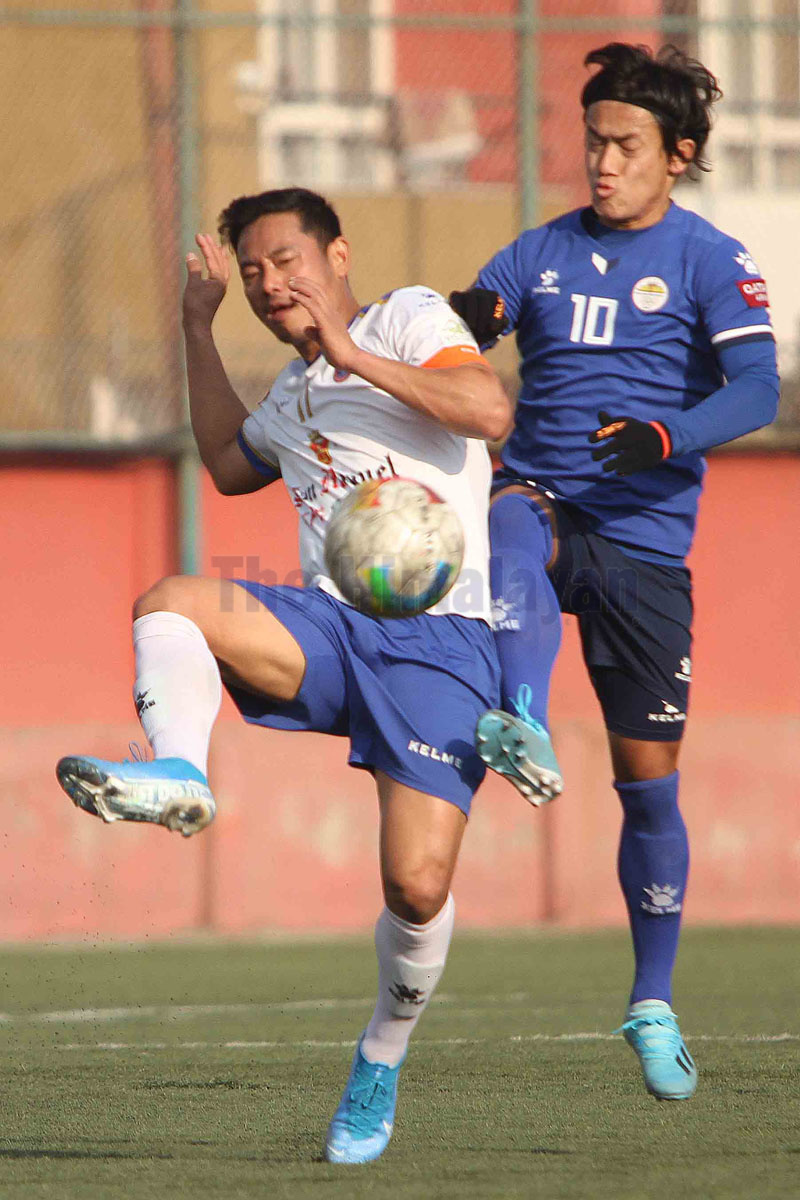 Dipak Rai of San Miguel Machhindra vies with Sankatau2019s Suvash Gurung (right) during the Qatar Airways Martyrs Memorial A Division League in Lalitpur on Monday. Photo: Udipt Singh Chhetry / THT