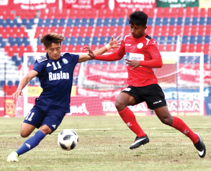 Ruslan Three Star Clubu0092s Sushil Rai (left) vies for the ball with Nepal Police Club player during their 18th Aaha-Rara Gold Cup Football Tournament match at the Pokhara Stadium in Kaski on Wednesday. Photo courtesy: Sudarshan Ranjit