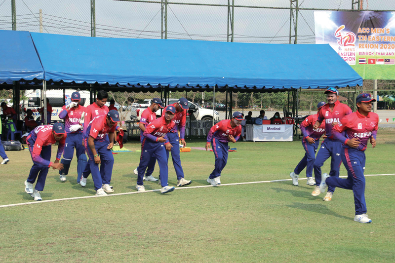 Nepal players enter the pitch to field against Hong Kong during their ACC Eastern Region T20 match at the Terdthai Cricket Ground in Bangkok on Sunday. Photo courtesy: Raman Shiwakoti