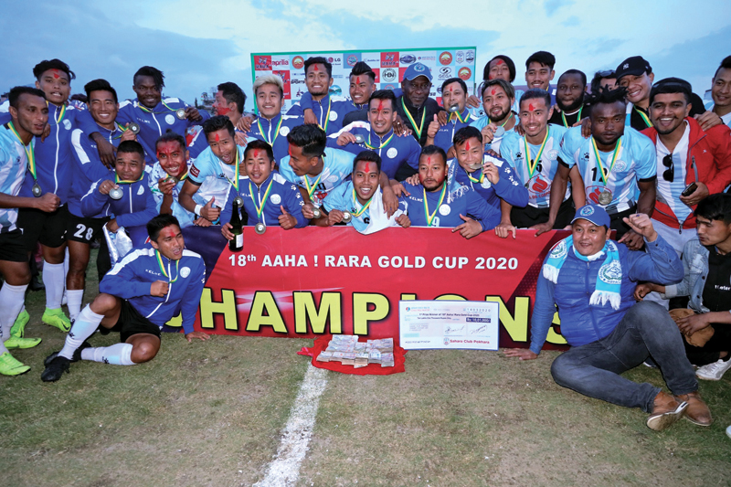 Players and officials of NOC Manang Marshyangdi Club celebrate with the trophy after winning the 18th Aaha-Rara Gold Cup in Pokhara on Saturday. (Down) Nepal Police Club's Ajit Bhandari rides on a scooter after being named the best player of the tournament. Photos Courtesy: Sudarshan Ranjit