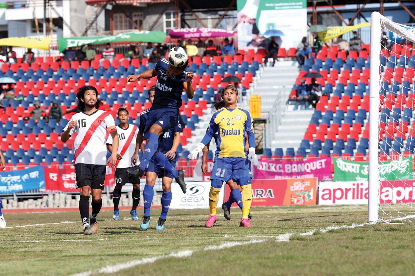 Action in the match between Gangtok Football Club (left) and Ruslan Three Star Club during the 18th Aaha-Rara Gold Cup Football Tournament at the Pokhara Stadium in Kaski on Monday. Photo courtesy: Sudarshan Ranjit