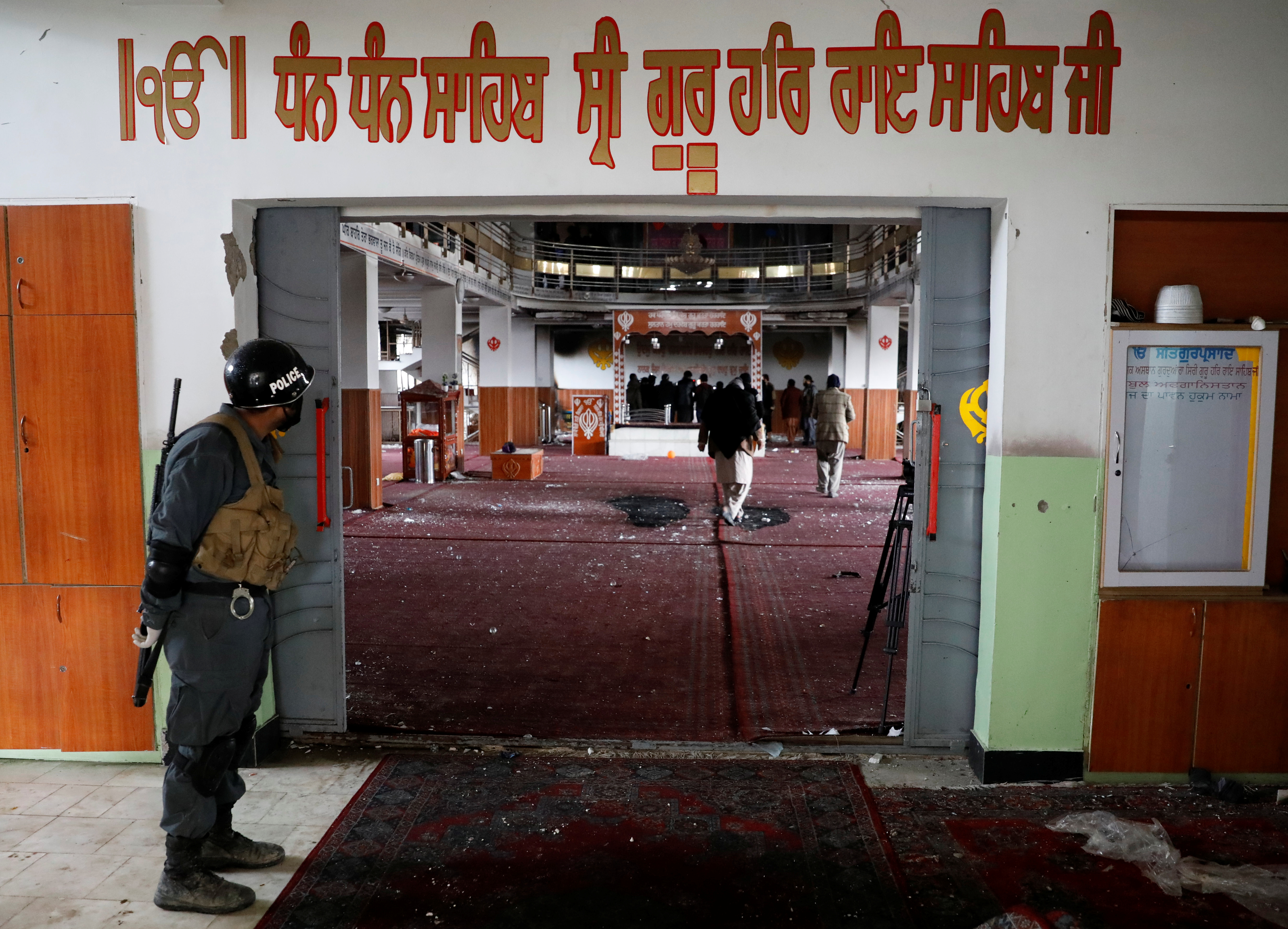 An Afghan policeman inspects inside a Sikh religious complex after an attack in Kabul, Afghanistan March 25, 2020. Photo: Reuters