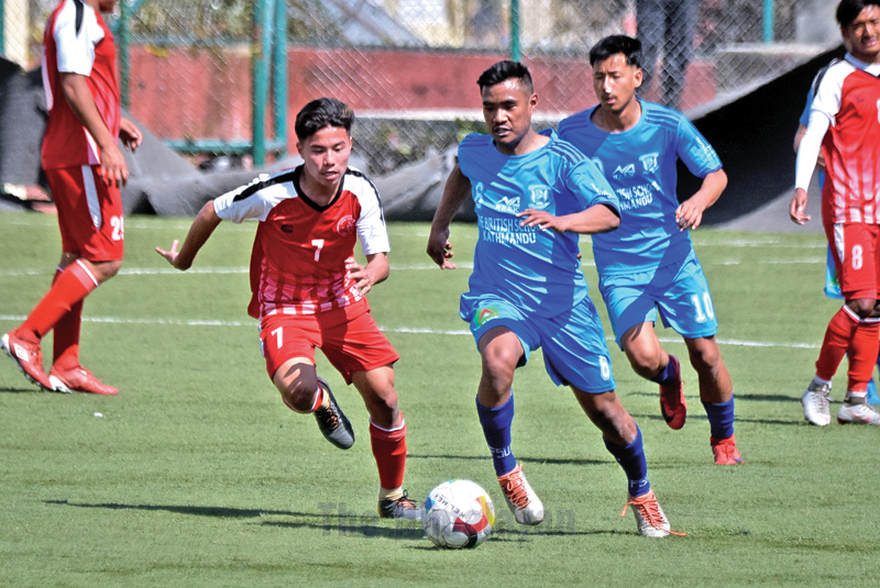 Pulchowk Sports Clubu2019s Shyrab Lo Tamang (left) vies with Jhamsikhel Youth Club players during their Martyrs Memorial B Division League match in Lalitpur on Sunday. Photo: Naresh Shrestha/THT
