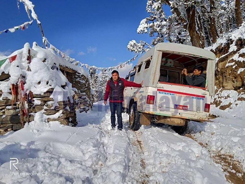 A jeep stuck at Porakhe Lekh along Martadi-Kolti road section due to heavy snowfall, in Bajura, on Friday. Photo: THT