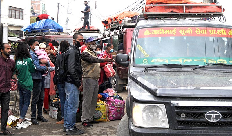 People looking for vacant seats in a jeep at Balkhu, Kathmandu, on Saturday. The number of people leaving Kathmandu valley via Nagdhunga, Jagati, Pharping and Nagarjun checkpoints has gone up amid the possible COVID-19 outbreak in the country. Photo: THT