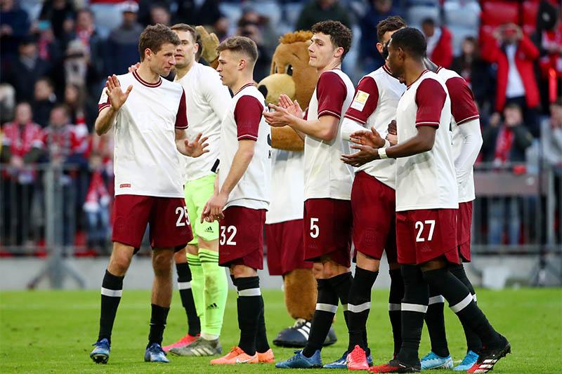 Bayern Munich players celebrate after the match. Photo: Reuters