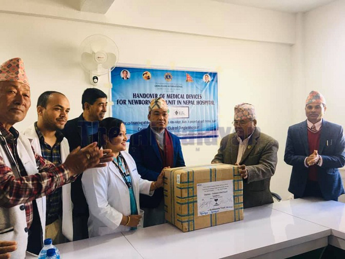 Former Tourism Minister Kripasur Sherpa handing over the materials to the District Hospital, Bhojpur. Photo: Niroj Koirala