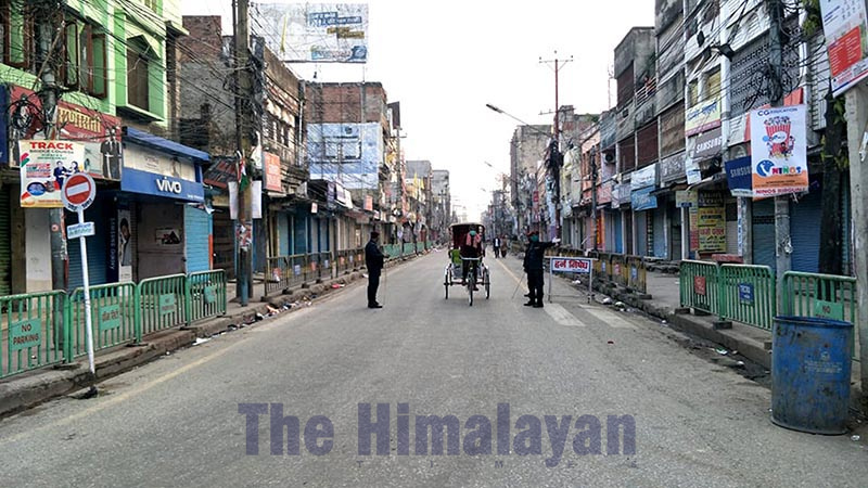 Security personnel are seen alongside a rickshaw in a deserted road after the government of Nepal reinforced the lockdown measures to combat the coronavirus disease (COVID-19) in Adarshanagar Chok, Birgunj Metropolitan City, Parsa district, on Tuesday, March 24, 2020. Photo: Ram Sarraf/THT