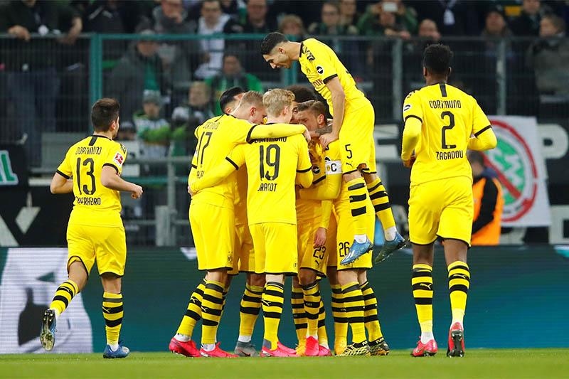 Borussia Dortmund's Thorgan Hazard celebrates scoring their first goal with teammates. Photo: Reuters